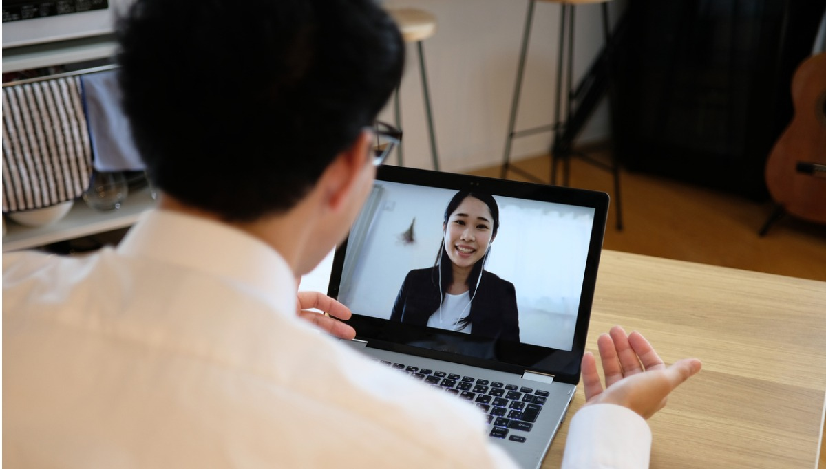 Asian business man talking to a woman on a web meeting